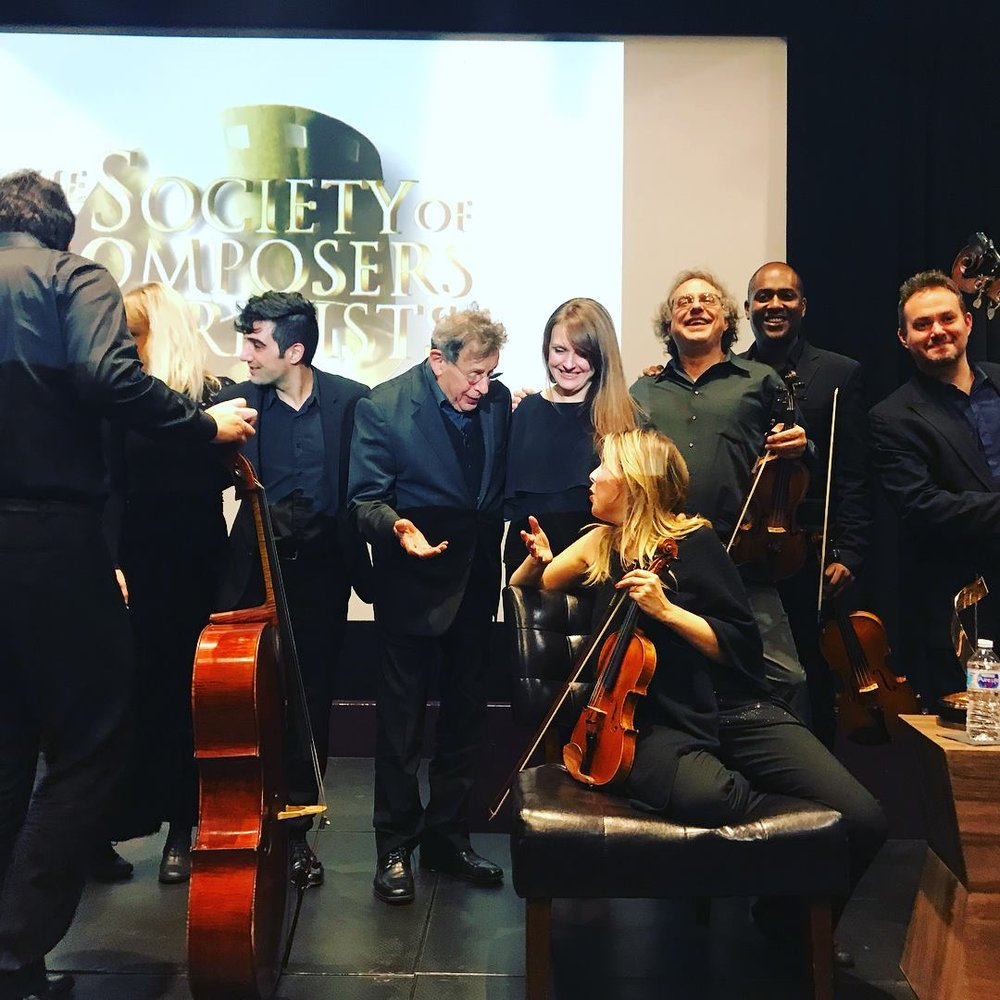 Members of American Modern Ensemble with Philip Glass at the  Society of Composers and Lyricists  annual holiday party and awards ceremony.