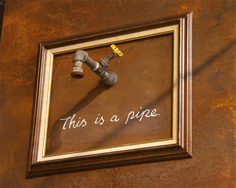 "Banksy's ""This is a pipe."""