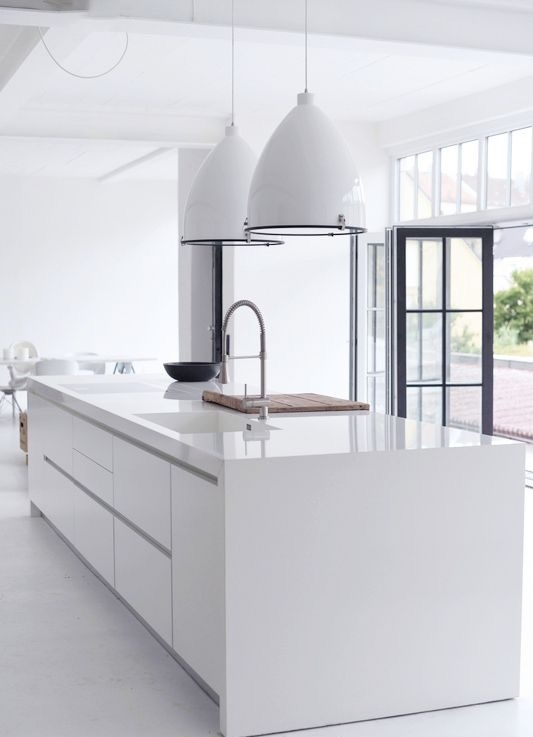 Stark white manufactured quartz counters by Pedini Kitchens