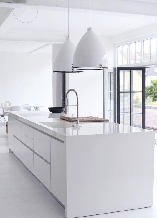 Stark white manufactured quartz counters by Pedini Kitchens