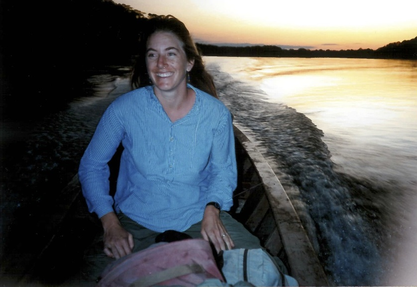 """The summer right after graduation from veterinary school (more than 20 years ago - yikes!), I spent 6 weeks in the Peruvian Amazon with my husband Jamie, surveying wild parrot species for viruses known to infect captive birds. The project was the culmination of a lot of mentoring and support I received while I was a veterinary student, especially from Walter Boyce, Linda Lowenstine, and Murray Fowler.  In this sunrise photo, it's the end of the season and we're starting our boat trip back down the Manu River from our field camp, heading home to Davis to start a residency in Primate Medicine. So the smile is for a lot of things: excitement about embarking on next steps as a brand-new (wildlife!) veterinarian, but mostly about the prospect of a hot shower and a cold beer.""  — Kirsten, Co-Director of the Karen C. Drayer Wildlife Health Center"