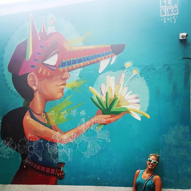 We are in #medellin #colombia  and there is some really excellent #graffiti #wallart #flowers #mask #art
