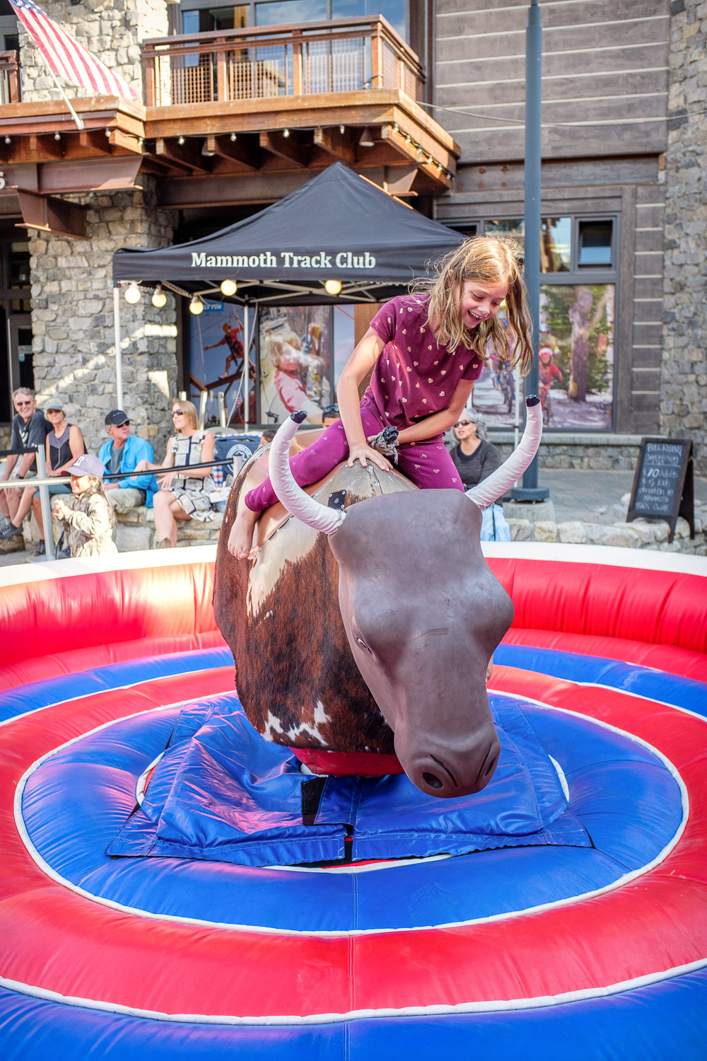 We decided to leave a day early and drive halfway to Mammoth Lakes, another one of our summer favorites. They were having an end-of-summer festival—along with mechanical bull rides. Ironically, it was Paige who had the courage to step into the ring at first and Quinn reluctantly followed after her.