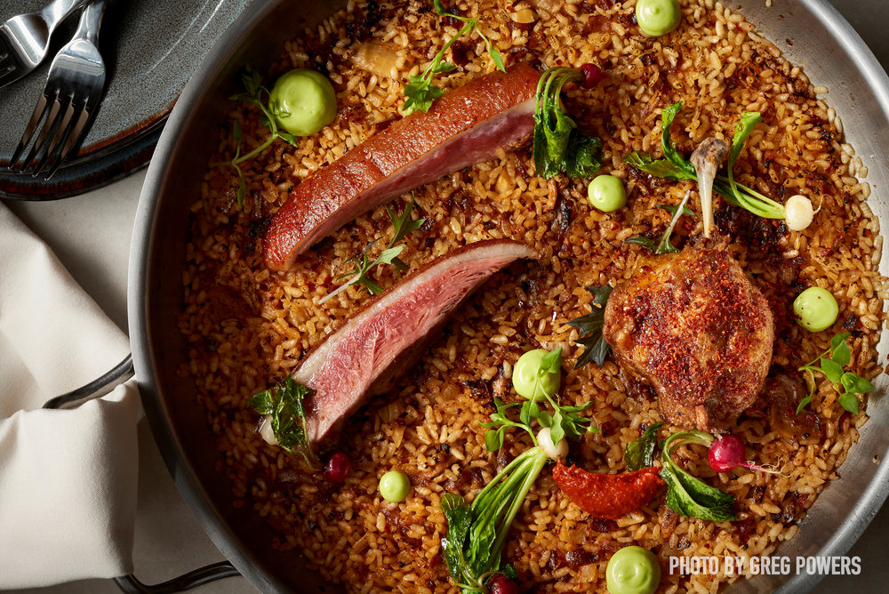 """You've got to try the bombas, our signature rice dishes,"" said Mike Isabella. Here, Arroz's aged duck bomba rice."