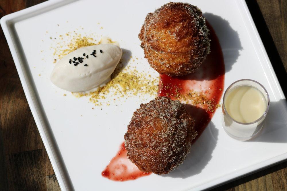 Sumac Sour Cherries with za'atar jelly doughnuts, halva ice cream, rosewater shooter. Photo by Fancy Radish