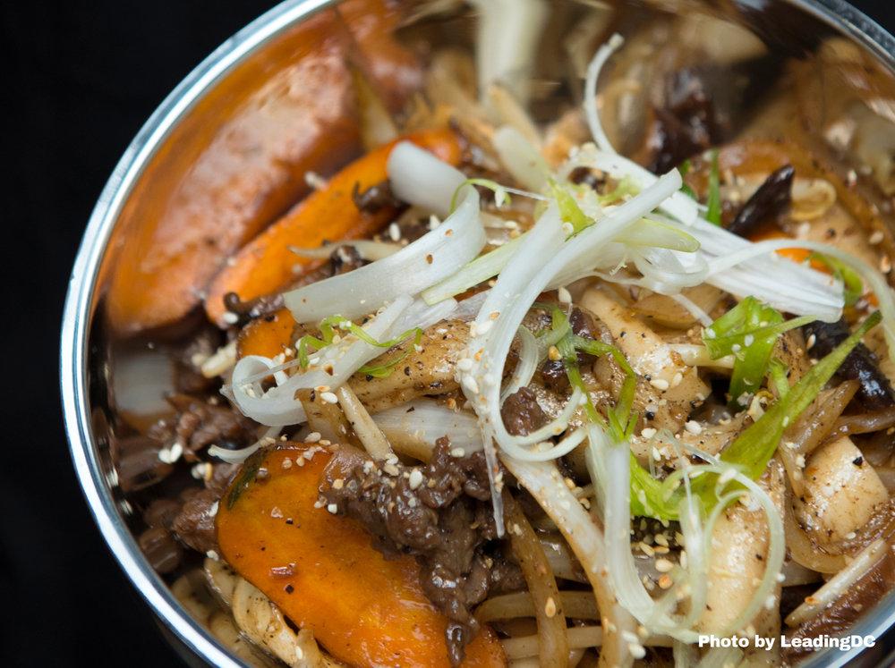 Rib eye & rice cakes with bulgogi, baby carrots and shiitakes