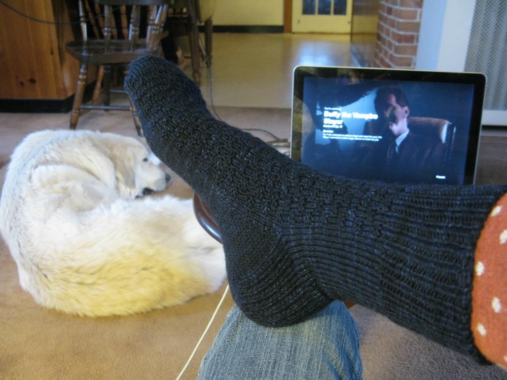 Knit socks, sleepy dog, & Buffy the Vampire Slayer.