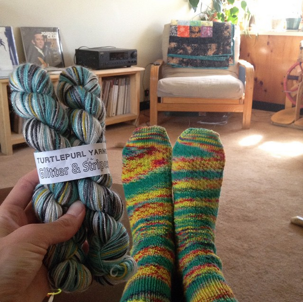 Wild, tutti frutti socks complete! That's what I'm calling them. I don't remember what the yarn was, but I got it back in 2007 in South Carolina with my girlfriends when we were celebrating our graduation from UMF! The other sock yarn in hand is Turtlepurl's self-striping yarn that I purchased while I was up in Halifax this past January. See next photo.