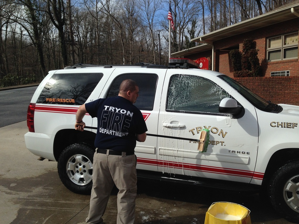Pictured is FF/EMT Lewis McSwain washing the Tahoe