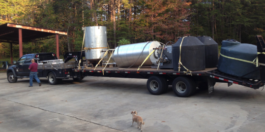 My moonshine looking distillation tank lays on its side, headed to a new home.  My big soap pot is getting even bigger.