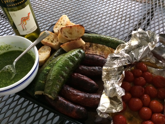 My current vehicle of choice for my Perfectly Green Pesto: grilled sausage, veggies and baguette... oh and the ever-stalwart Yellowtail chardonnay