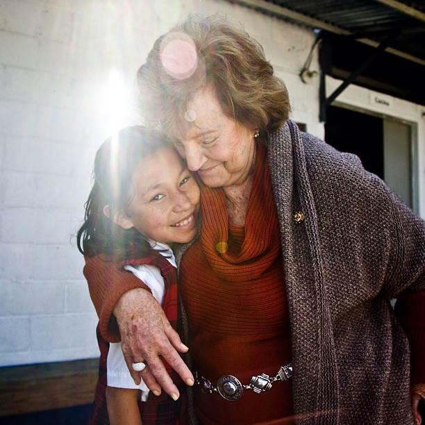 The first  #woman   #Rotarian  in  #Guatemala  and founder of  #Fundaninas , Isabela Bosch, embraces a girl living at the  #orphanage . The project houses, feeds and  #educates  girls from 2 years old to 18 with help from #RotaryFoundation  matching grants including bunk beds, sheets, pillows, bathrooms and a kitchen with a  #soycow  for milk and baking. Rotary International/Monika Lozinzska