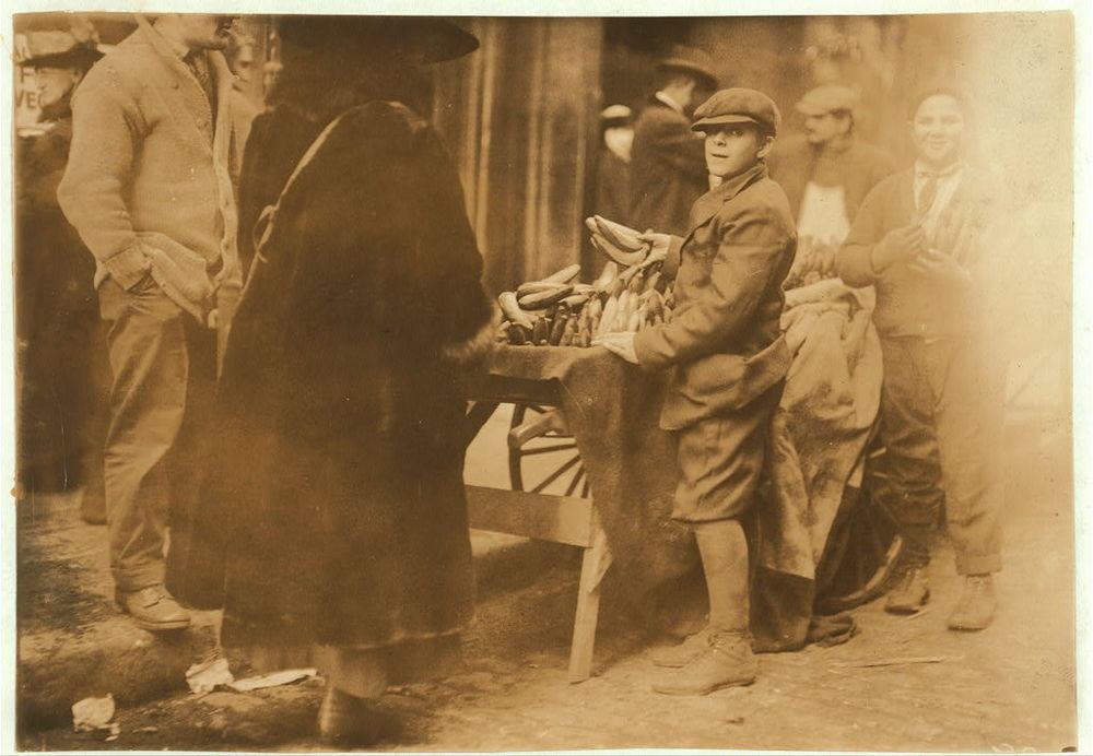 This 1917 photograph by Lewis Hine shows a boy peddling bananas in Boston.  Image courtesy Library of Congress.