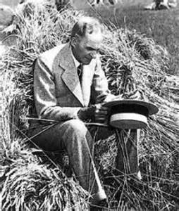 Henry Ford in his soy-blend suit, seated carefully on a haystack. Image from Greg Grandin's book, Fordlandia.