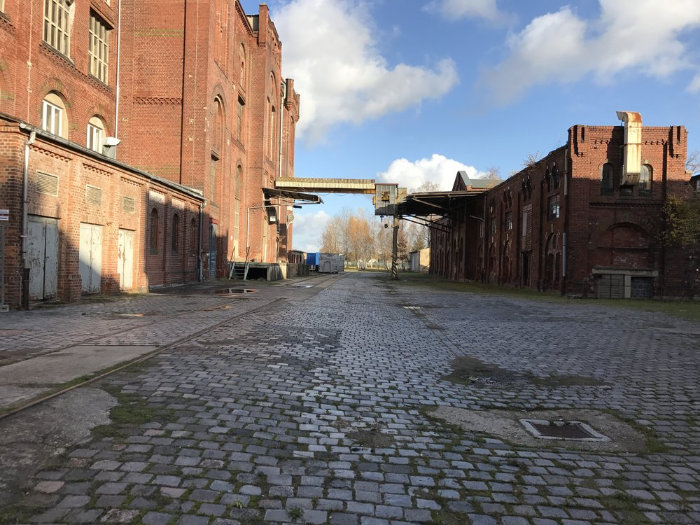 Main factory building on the left. The building on the right was one of the boiler-stack buildings. The smokestack was demolished in the early 1990s, after Bell bought the property.