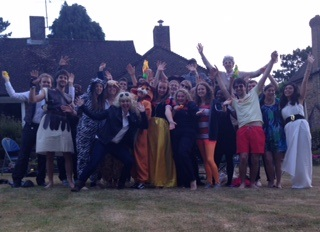 Students celebrating the end of term with a fancy dress themed BBQ