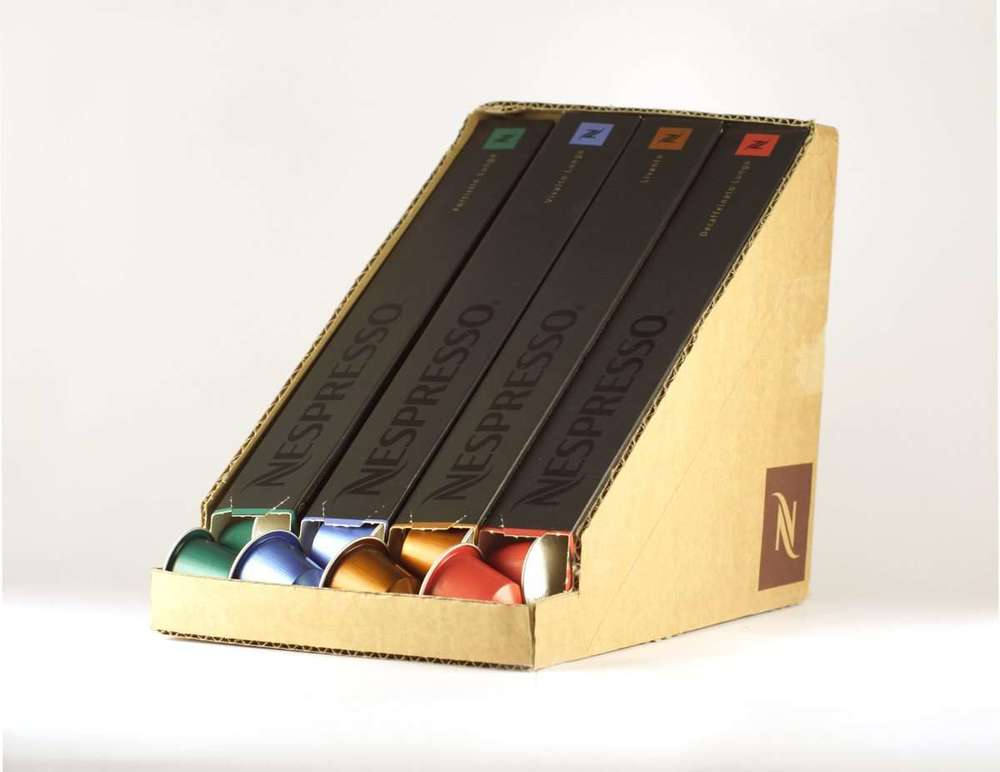 Nespresso capsule dispenser made from an old capsule shipping package