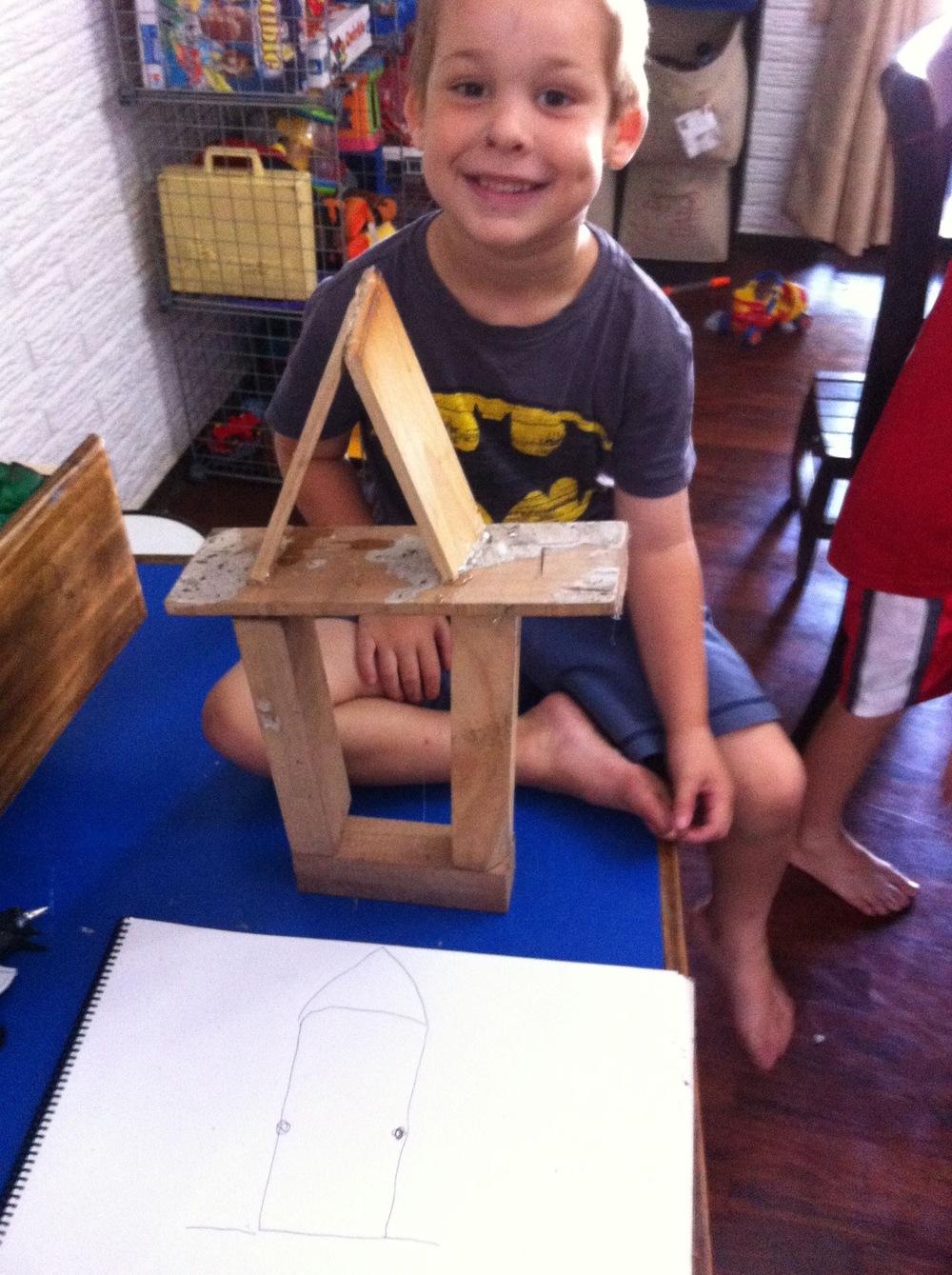 Joel designing his own bird feeder