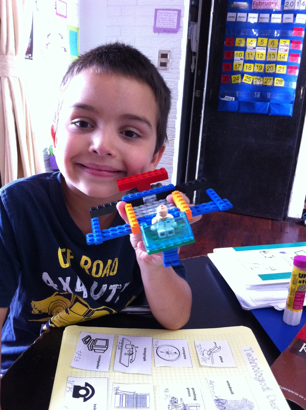Daniel designing his own form of transport - a plane with legs.