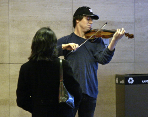 Joshua Bell busking in a subway. Would anyone notice? Image source