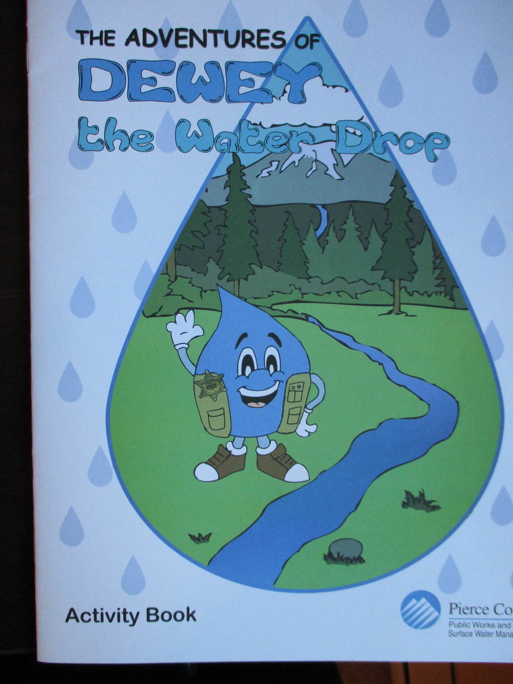 And how about this friendly li'l guy who misleads school children everywhere? Water droplets are not teardrop shaped. Rain drops are not teardrop shaped. Even tears are not teardrop shaped! Only when water leaks or drips slowly out of a faucet does it resemble this shape. Rain drops are the shape of a hamburger bun--slightly convex on top. But who wants to learn about their watershed or the water cycle from a blue hamburger bun?