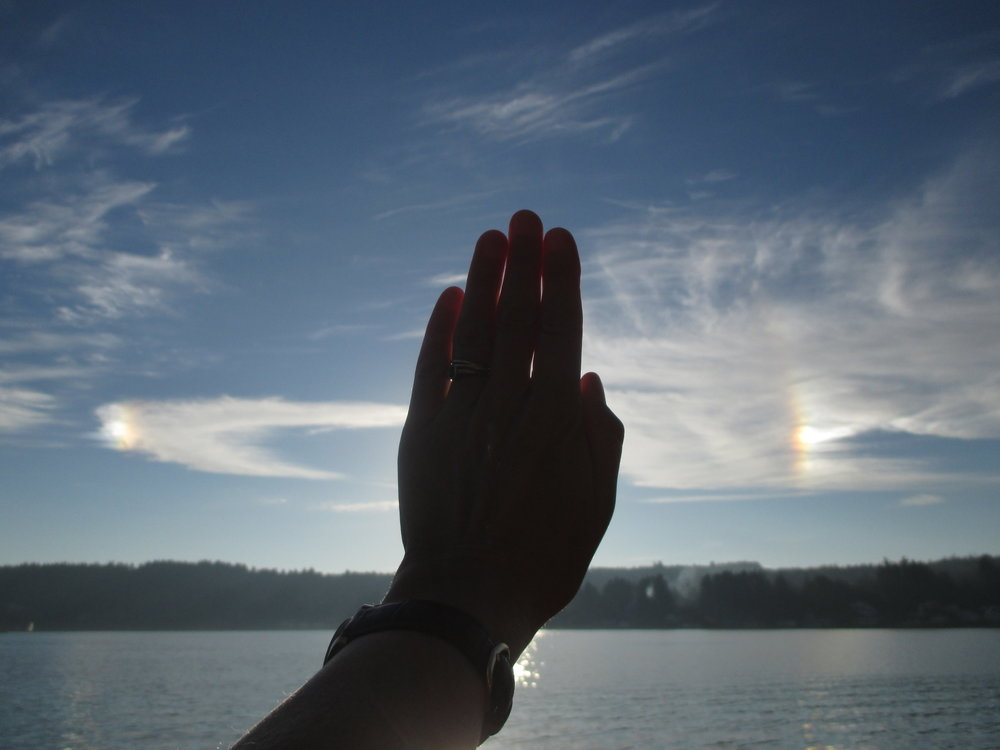 "Cirrus showing parhelia, an optical phenomenon also known as ""sundogs."""