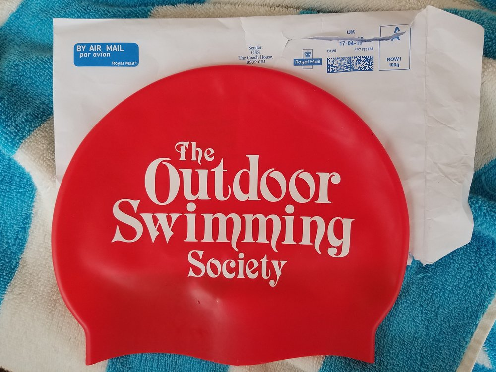 This lovely silicone swim cap keeps your head warm (ish) and increases your visibility among boaters. It makes a great gift (thanks Max!)