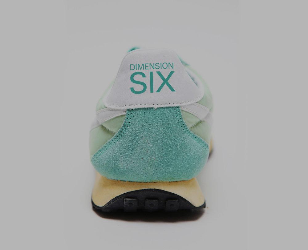 nike-mens-pre-montreal-sneaker-back-view.jpg