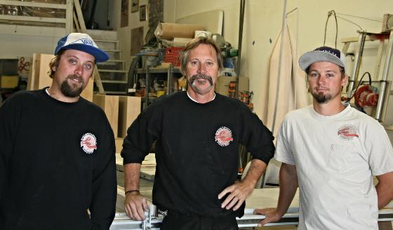 Travis, Randy, and Jeremy working in the cabinet shop.