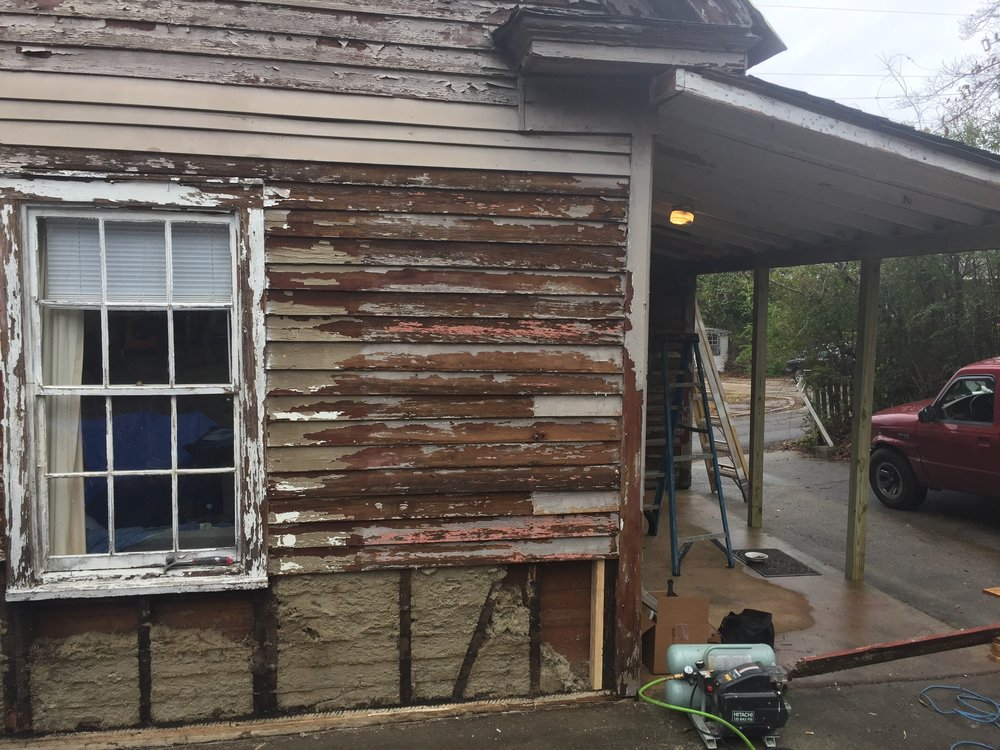 East side, paint scraped and bottom siding removed