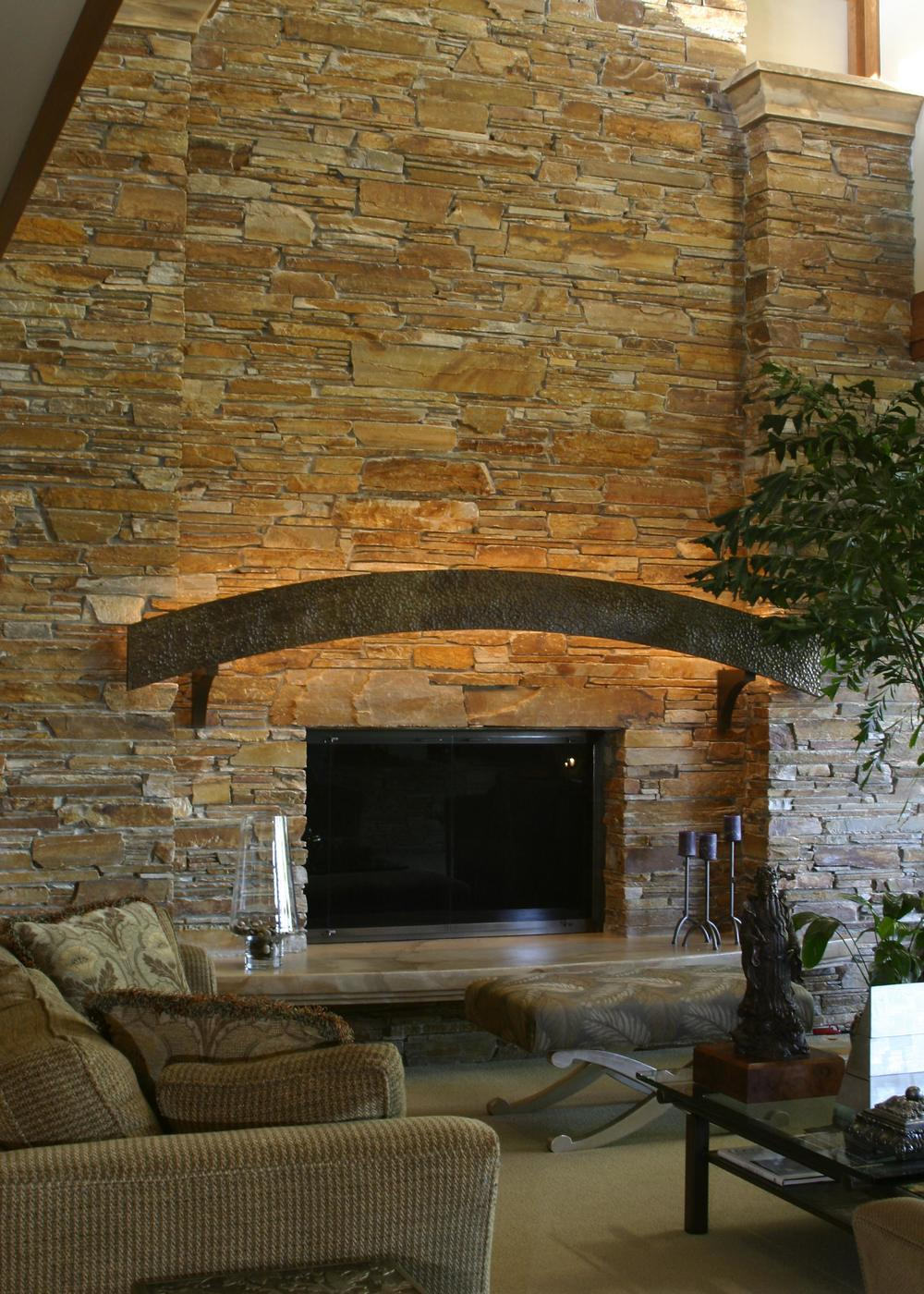 Fireplace and metal mantle.