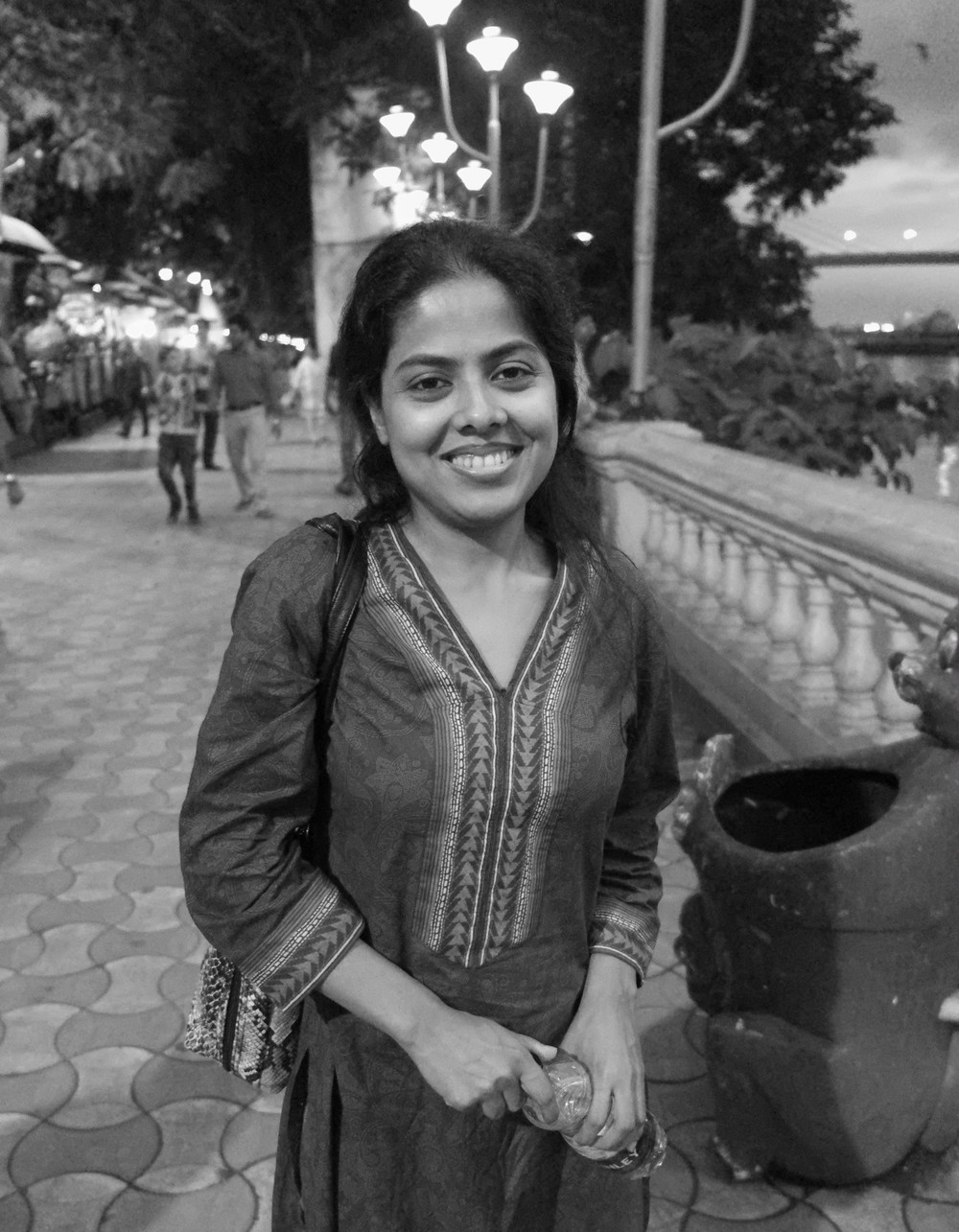 suchismita, along the river, with a bottle of water, in kolkata, august 2014