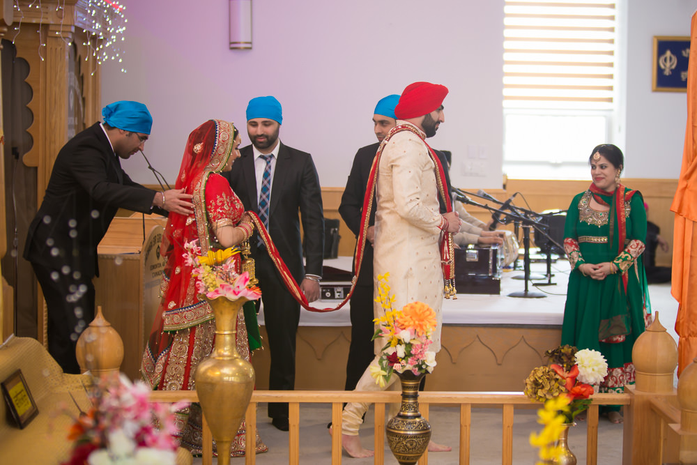 It is to symbolize that the altar, or the officiant, or the Guru, is at the center of the marriage.
