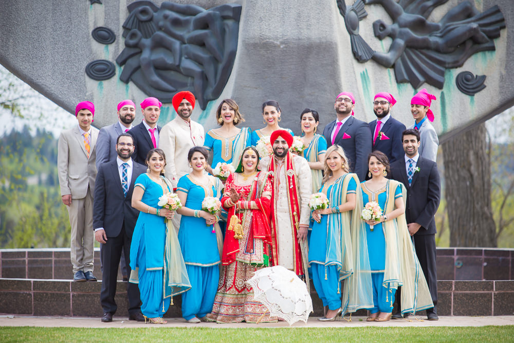 The lovely bridesmaids and the debonair groomsmen with the stunning bride and groom.
