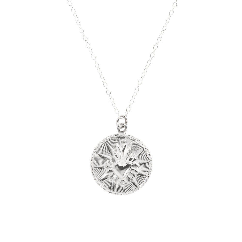 Silver - Solid Sterling SilverMight tarnish over time, easy to clean. Hypoallergenic.Necklaces come with solid sterling silver chain.Cleaning:Brush lime + baking soda, rinse and dry.