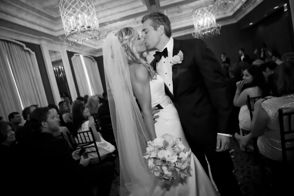 2. Ashley is wearing the Krisa trumpet cut gown, custom swarovski crystal sash & cathedral veil from the Victoria Sdoukos Couture Collection. Wedding held at the Waldorf Astoria Chicago. She was Glamorous and oh so chic!!! Photography:http://www.colinlyonsphotography.com/