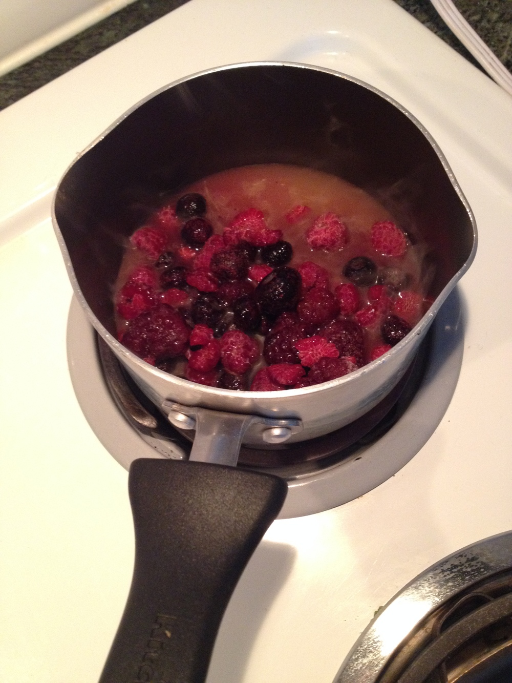 Put berries and juice together in a pot. Turn the stove to high and wait for berries and juice to boil
