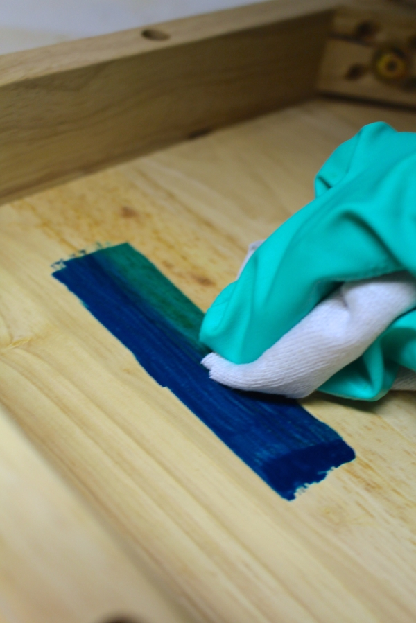 Wiping away dye on wood