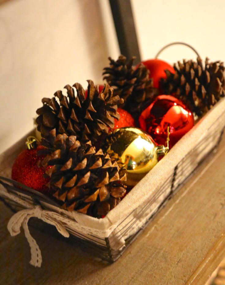 Pine cones and ornaments in baskets