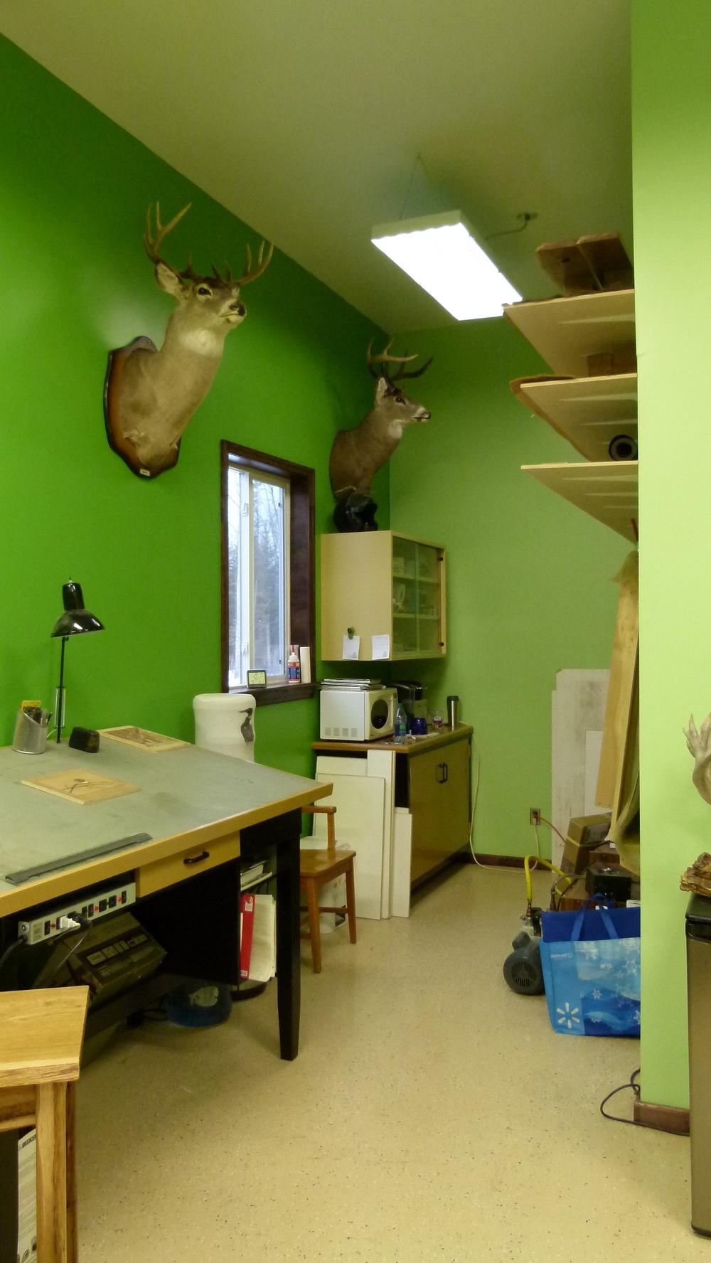 Veneer press (folded up against wall) and veneer storage area.