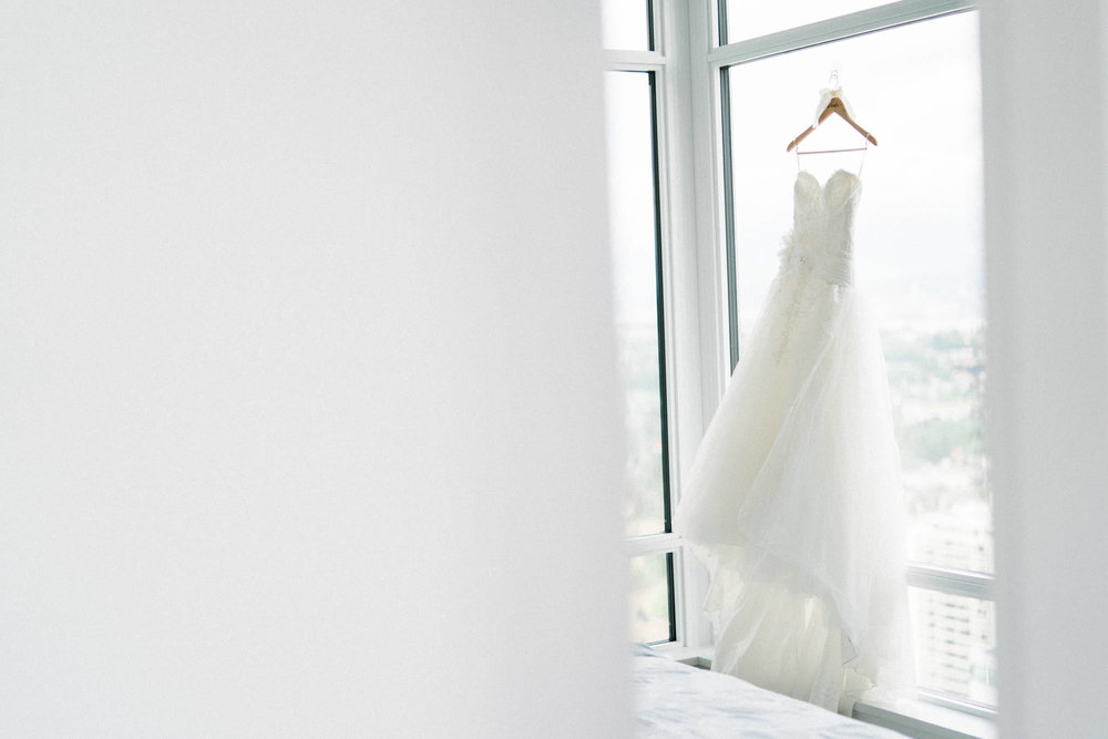 Wedding dress hung by window