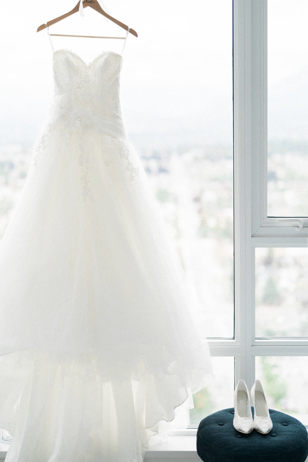 Wedding dress and shoes by the window