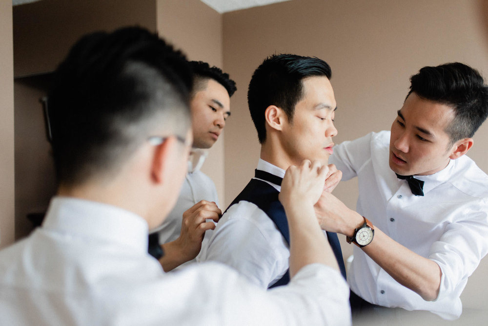 Groom getting ready for wedding at Hart House