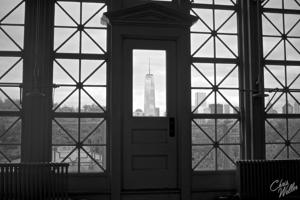 Taken on Ellis Island, with a view of the Freedom Tower through the very windows that America's new citizens saw the hope of a new life.