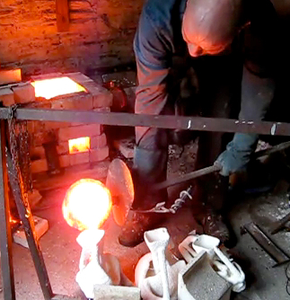 Pouring Bronze at 1200˚c into ceramic shell moulds