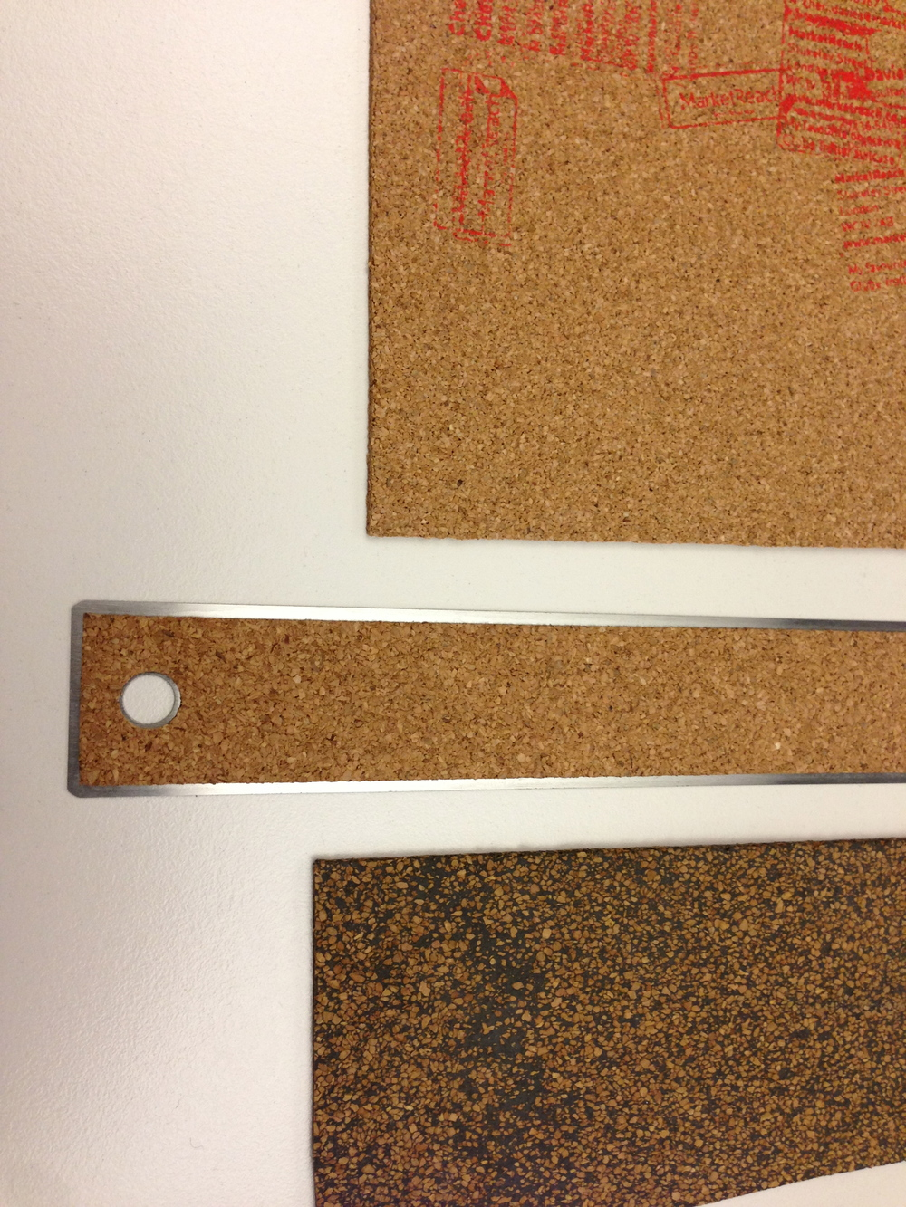 Two types of cork available, normal and nitrile composite. We chose the nitrile as it would allow us to print in white...even though it wasn't quite authentic.