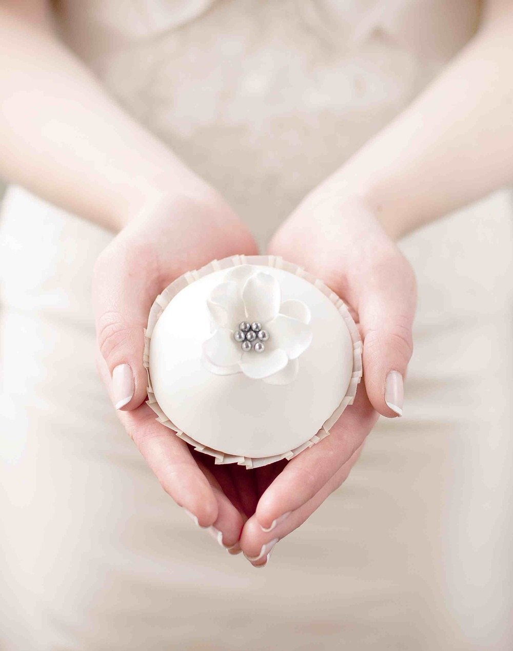 Simple, delicate wedding cupcake. Cake by The Chipping Norton Tea Set. Photo by Cristina Colli