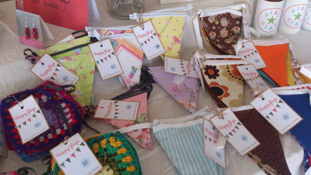 Most of the bunting was sold, especially the crochet squares, to funky mamas of new babies. The paper bunting was made out of quarters of scrapbooking paper, folded and stitched into ribbon. I probably could have sold more bunting in little girl tones.