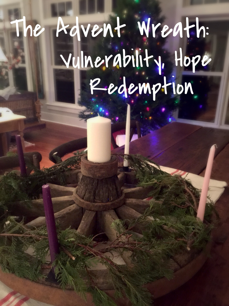 My Advent Wreath - An antique wagon wheel with the five appropriate candles.