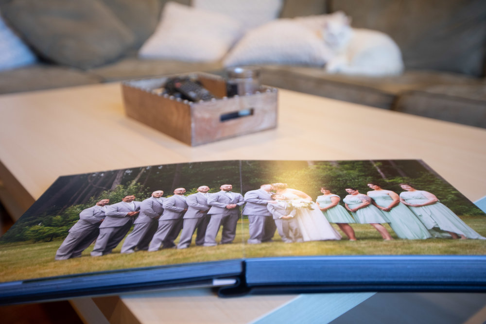 Quick photo I had of an album that I had made for around two hundred and fifty dollars. fifty pages and glass cover.
